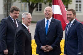 U.S. Secretary of Defense Jim Mattis greets Lithuania's Minister of Defense Raimundas Karoblis, left, Estonia's Minister of Defense Margus Tsahkna, right, and Latvia's Minister of Defense Raimonds Bergmanis, during a meeting in Vilnius, Lithuania, Ma