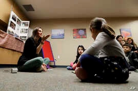 FILE - In this Jan. 23, 2019 photo, Bahareh Hedyahe leads Persian story time at Irvine public library in Irvine, Calif.