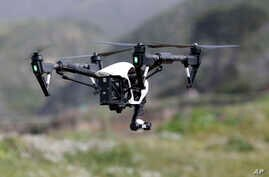 FILE - The Inspire 1, a drone manufactured by DJI, is flown in Davenport, Calif., March 10, 2015.