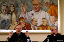 Chilean bishops Luis Fernando Ramos Perez and Juan Ignacio Gonzalez Errazuriz attend a news conference ahead of three days of closed-door crisis meetings with Pope Francis at the Vatican, May 14, 2018.
