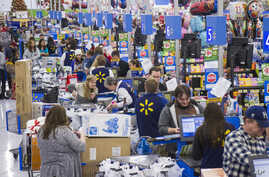 Sales clerks ring up customers at Walmart in Bentonville, Arkansas. More Americans work in retail and as cashiers than in any other occupations.