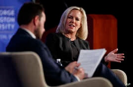 Homeland Security Secretary Kirstjen Nielsen, joined by director of Auburn University's McCrary Institute for Cyber and Critical Infrastructure Security, Frank Cilluffo, speaks at George Washington University's Jack Morton Auditorium in Washington, M