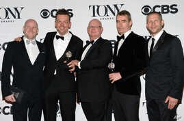 """Simon Stephens, second right, Michael Morris, second left, and the crew accept the award for best play for """"The Curious Incident of the Dog in the Night-Time"""" at the 69th annual Tony Awards at Radio City Music Hall on Sunday, June 7, 2015, in New Yor"""