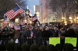 Protesters gather at Brooklyn Borough Hall to protest President Donald Trump's immigration order, Feb. 2, 2017, in New York.