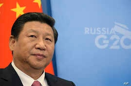 China's President Xi Jinping, prior to a meeting with Russia's President Vladimir Putin at the G-20 summit in St. Petersburg, Russia, Sept. 5, 2013.