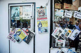 FILE - Newspapers and magazines are seen on a display in a kiosk in the center of Tehran, Iran.