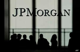 The JPMorgan Chase & Co. logo is displayed at their headquarters in New York, Oct. 21, 2013.