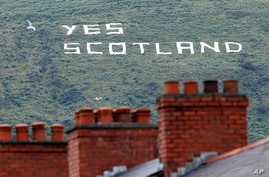 Republican writing supporting the Yes vote in the Scottish Referendum on a mountain in West Belfast, Northern Ireland, Sept. 8, 2014.