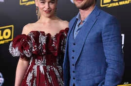 "Emilia Clarke and Alden Ehrenreich arrive at the premiere of ""Solo: A Star Wars Story"" at El Capitan Theatre, May 10, 2018, in Los Angeles."