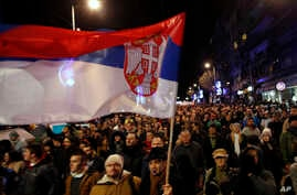 People march during a protest against populist President Aleksandar Vucic in Belgrade, Serbia, Feb. 2, 2019.