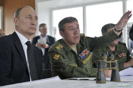 FILE - Russian President Vladimir Putin (L) and Chief of Staff Valery Gerasimov watch military exercises in Russia's Zabaykalsky region.