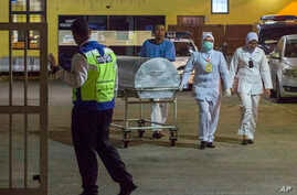 Medical staff push a metallic bed, which is used for transporting bodies, from the forensic department at Kuala Lumpur Hospital in Kuala Lumpur, Malaysia, Feb. 19, 2017.