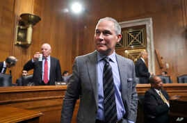 FILE - Environmental Protection Agency Administrator Scott Pruitt arrives to testify before the Senate Environment Committee on Capitol Hill in Washington, Jan. 30, 2018.
