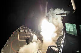 The USS Ross fires a Tomahawk missile, April 7, 2017, from the Mediterranean. The United States blasted a Syrian airfield with a cruise missiles in retaliation for this week's chemical weapons attack against civilians.