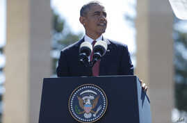 President Barack Obama  speaks at Normandy American Cemetery at Omaha Beach as he participates in the 70th anniversary of D-Day in Colleville sur Mer in Normandy, France, Friday, June 6, 2014.