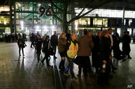 Spectators leave the HDI Arena after cancellation of an exhibition football match between Germany and the Netherlands because of a bomb threat in Hanover, Germany, Nov. 17, 2015.