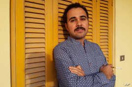 FILE - Egyptian author Ahmed Naji poses for a photo in Cairo, Egypt, in this undated image. Naji was sentenced to two years in jail on Saturday, Feb. 20, 2016, by a Cairo appeals court for publishing a sexually explicit excerpt of his novel that pros