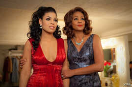 Sparkle (Jordin Sparks) and Emma (Whitney Houston, Exec. Producer) standing in the mirror. (Photo: Alicia Gbur) © 2012 Stage 6 Films, Inc. All Rights Reserved