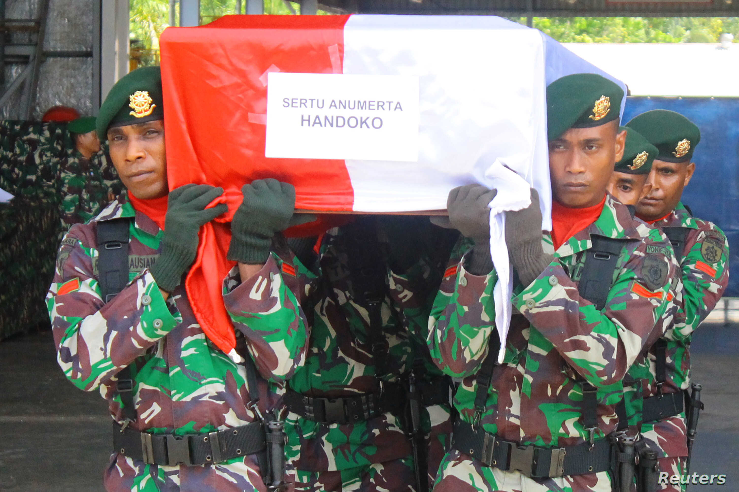 Indonesian soldiers carry the coffin of a sergeant who was killed during a battle with a separatist group suspected of killing construction workers in Indonesia's eastern province of Papua, at Mozes Kilangin airport in Timika, Papua, Indonesia, Dec.