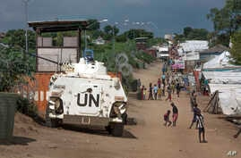 A United Nations armored personnel carrier stands in a camp for the internally-displaced in Juba, South Sudan,  July 25, 2016. The U.N. Mine Action Service says it is still working to clear explosive hazards around Juba.