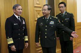 U.S. Navy Admiral Harry B. Harris, Jr., Commander U.S. Pacific Command (L) is shown the way by  China's PLA Chief of Staff General Fang Fenghui (C) as they proceed to their meeting at the Bayi Building in Beijing, China, Nov. 3, 2015.