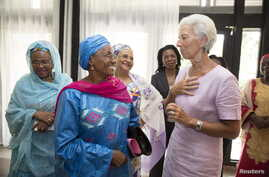 FILE - International Monetary Fund Managing Director Christine Lagarde meets with women leaders at the Hotel Pullman for lunch, Jan. 9, 2016 in Douala, Cameroon.