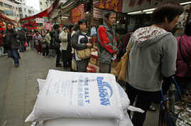 Customers line up outside a store in Hong Kong March 17, 2011, as shoppers in the Chinese territory rush to buy salt, which they believe could help to protect them from radiation.