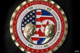 A coin for the upcoming U.S.-North Korea summit is seen in Washington, May 21, 2018.