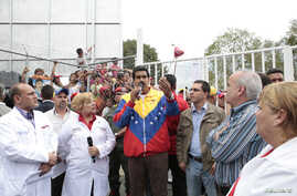 Venezuela's President-elect Nicolas Maduro (C) speaks during a visit to the Center of Integral Medical Diagnosis (CDI) of the Barrio Adentro health programe in Caracas, in this picture provided by Miraflores Palace, April 16, 2013.