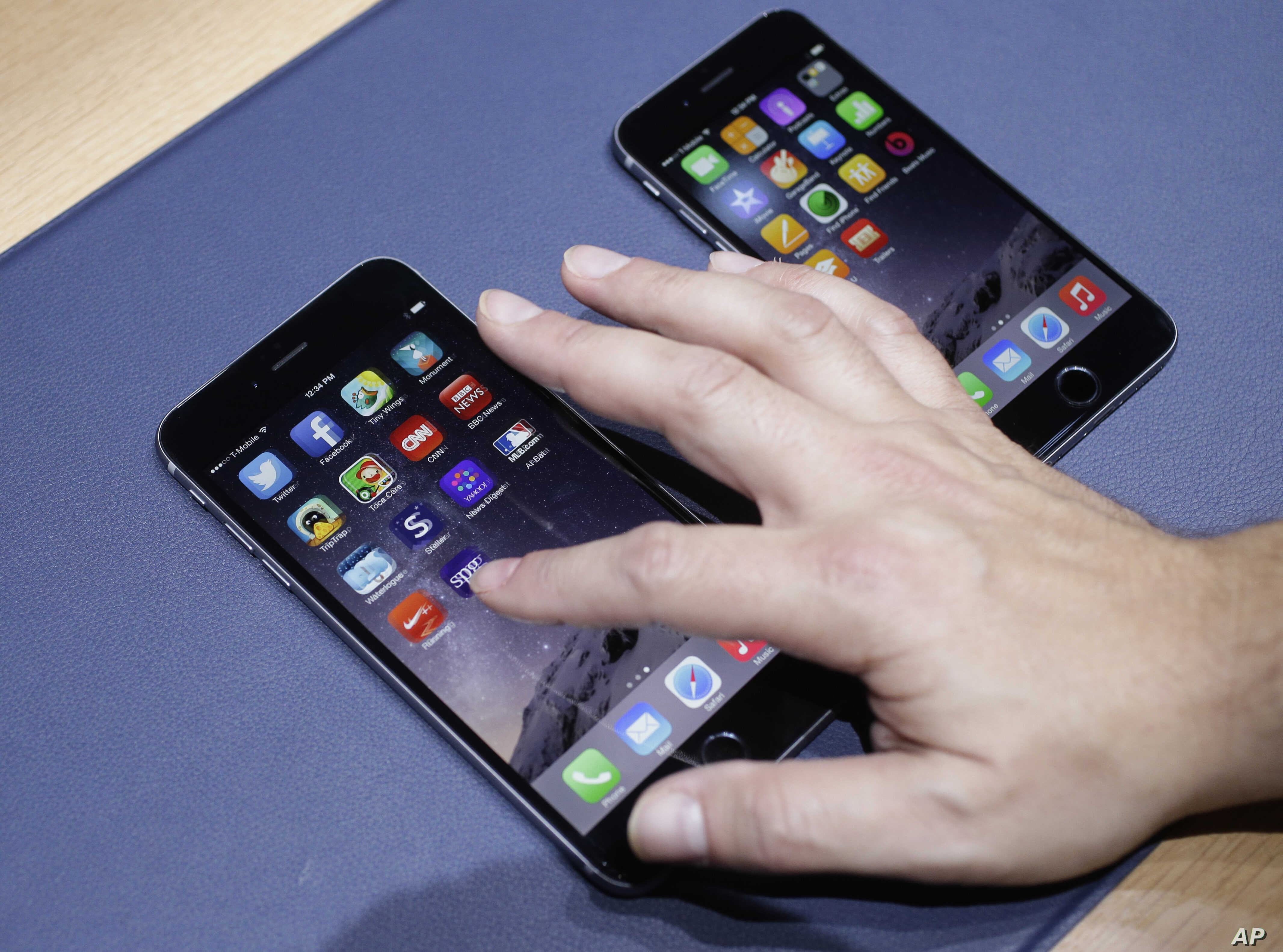 The iPhone 6 plus, at left, and iPhone 6 are displayed on  Sept. 9, 2014, in Cupertino, Calif.