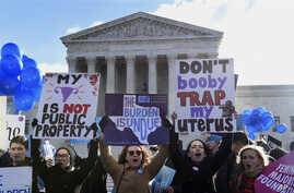 Pro-abortion rights protesters rally outside the Supreme Court in Washington, March 2, 2016. The abortion debate is returning to the Supreme Court in the midst of a raucous presidential campaign and less than three weeks after Justice Antonin Scaliaâ...