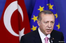 Turkey's President Tayyip Erdogan at the European Union Commission headquarters in Brussels, Belgium, Oct. 5, 2015. Istanbul's working-class, socially conservative Kasimpasa neighborhood helped shape the man who would become Turkey's most powerful fi