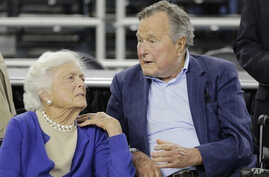 FILE - Former President George H.W. Bush and his wife Barbara Bush are seen in a March 29, 2015, photo.