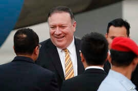 U.S. Secretary of State Michael Pompeo is greeted by local officials as he arrives at the military airport in Subang, outside of Kuala Lumpur, Malaysia, Aug. 2, 2018.