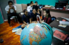 Christian Burmese refugees sit in a classroom in Kuala Lumpur, Malaysia, M arch 11, 2017. An Associated Press analysis suggests that the people hurt most by President Donald Trump's planned deep cuts in refugee visas are from not any of the six Musli