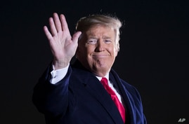 President Donald Trump waves after speaking during a rally for Sen. Cindy Hyde-Smith, R-Miss., at Tupelo Regional Airport, Nov. 26, 2018, in Tupelo, Miss.