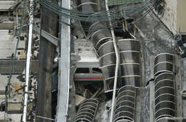 A derailed New Jersey Transit train is seen under a collapsed roof after it derailed and crashed into the station in Hoboken, New Jersey, U.S. Sept. 29, 2016.