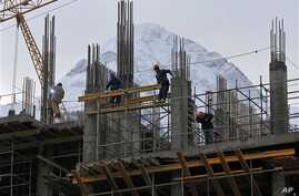 In preparation for the 2014 Winter Games at the Black Sea resort of Sochi, a hotel under construction, Krasnaya Polyana, Russia, Feb. 4, 2013.