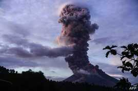 The Mayon volcano spews lava as it continues to erupt, as seen from Daraga town, in Albay province, south of Manila on January 23, 2018.