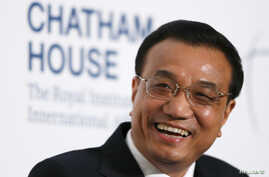China's Premier Li Keqiang smiles as he is introduced at an event co-hosted by Chatham House and The International Institute for Strategic Studies at Mansion House in London, June 18, 2014.