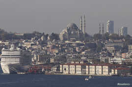 FILE - Minarets of the Ottoman-era Suleymaniye mosque punctuate Istanbul's skyline. Turkey is building mosques abroad as President Tayyip Erdogan seeks to expand influence in the Muslim world.