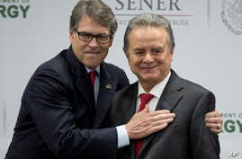 U.S Energy Secretary Rick Perry embraces Mexico's Secretary of Energy Pedro Joaquin Coldwell, after they made a joint statement in Mexico City, July 13, 2017.