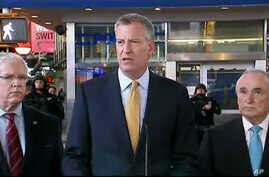 In this photo provided by WNYW Fox 5 NY, New York Mayor Bill de Blasio speaks during a news conference in New York's Times Square, Wednesday, Nov. 18, 2015.