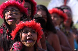 Brazilian Pataxo women take part in a ritual dance during a protest against a proposed constitutional amendment that would put the demarcation of indigenous lands into the hands of the Congress, in front of the Brazil's National Congress, in Brasilia