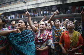 Garment workers shout as they call on other workers to join them during a protest in Dhaka September 23, 2013.