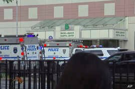 In this image taken from video, emergency personnel converge on Bronx Lebanon Hospital in New York, after a gunman opened fire there, June 30, 2017.