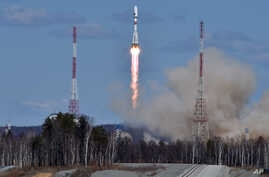 A Russian Soyuz 2.1a rocket carrying Lomonosov, Aist-2D and SamSat-218 satellites leaves a trail of smoke as it lifts off from the new Vostochny cosmodrome  outside the city of Uglegorsk, about 200 kilometers (125 miles)  from the city of Blagoveshch