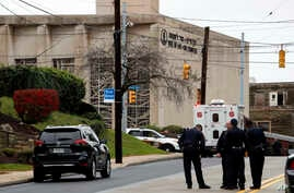 First responders stand outside the Tree of Life Synagogue in Pittsburgh, where a shooter opened fire, Oct. 27, 2018, injuring multiple people, including police officers.