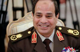 FILE - In this Thursday, Feb. 13, 2014 file photo, Egypt's military chief Field Marshal Abdel-Fattah el-Sissi smiles as he speaks to Russian Foreign Minister Sergey Lavrov during their talks in Moscow, Russia