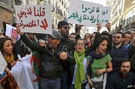 Demonstrators rally to denounce President Abdelaziz Bouteflika's bid for a fifth term, in Algiers, Algeria, Feb. 24, 2019.
